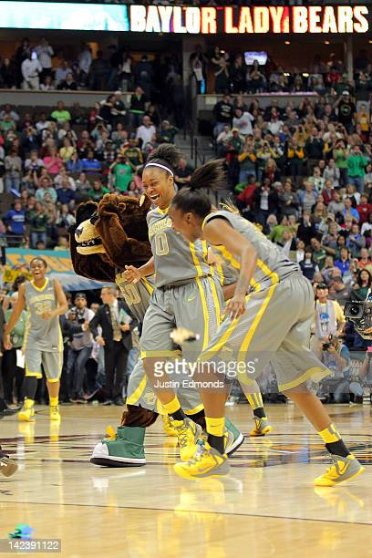 Odyssey Sims and Jordan Madden of the Baylor Bears celebrate after they won 8061 against the Notre Dame Fighting Irish during the National Final game...