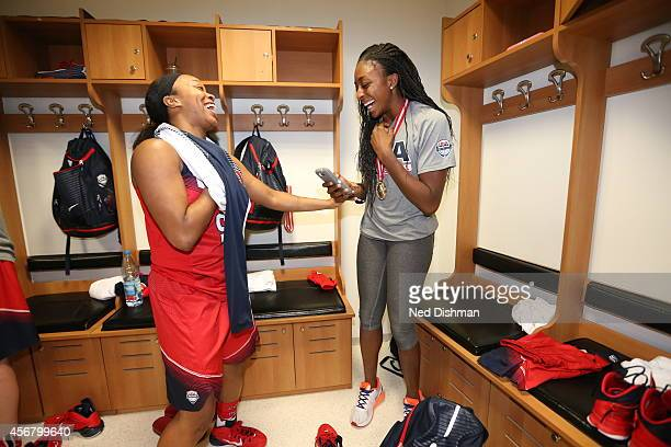 Odyssey Sims and Nnemkadi Ogwumike of the Women's Senior US National Team celebrate in the locker room after defeating Spain during the finals of the...