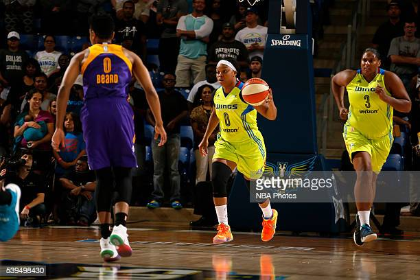 Odyssey Sims of the Dallas Wings brings the ball up court against the Los Angeles Sparks on June 11 2016 at College Park Center in Arlington Texas...