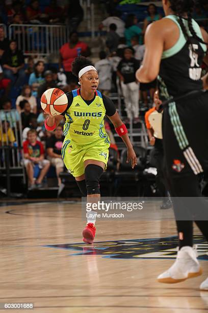 Odyssey Sims of the Dallas Wings drives to the basket against the New York Liberty on September 11 2016 at College Park Center in Arlington Texas...