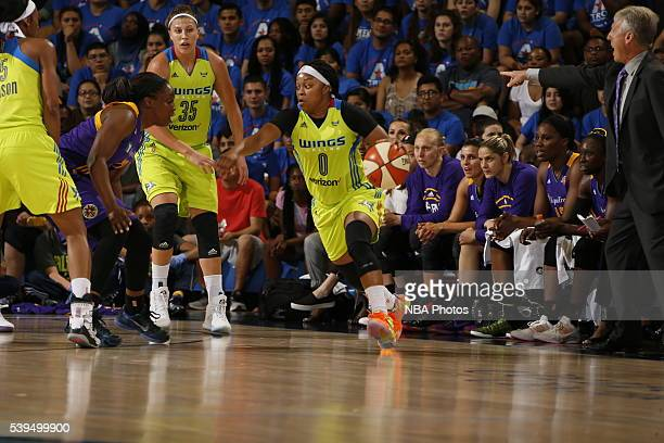 Odyssey Sims of the Dallas Wings handles the ball against the Los Angeles Sparks on June 11 2016 at College Park Center in Arlington Texas NOTE TO...