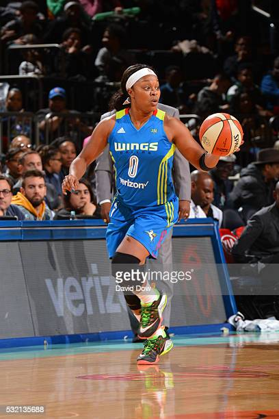 Odyssey Sims of the Dallas Wings handles the ball against the New York Liberty on May 15 2016 at the Madison Square Garden in New York City New York...