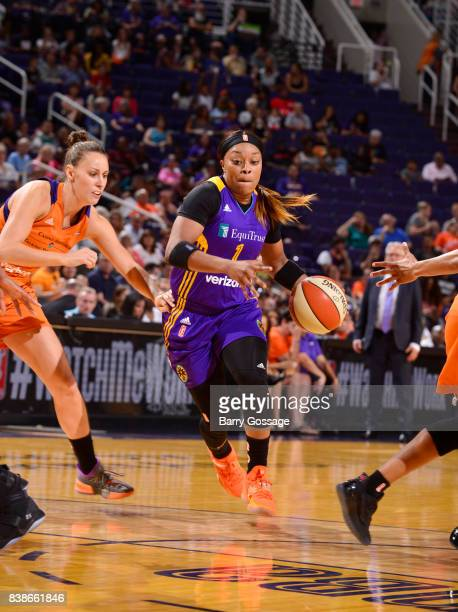 Odyssey Sims of the Los Angeles Sparks drives to the basket against the Phoenix Mercury on August 24 2017 at Talking Stick Resort Arena in Phoenix...