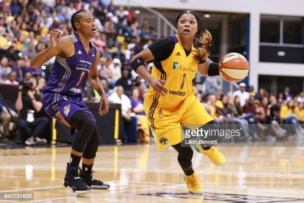 Odyssey Sims of the Los Angeles Sparks during a time out against Yvonne Turner of the Phoenix Mercury in game two of the Semifinals during the 2017...