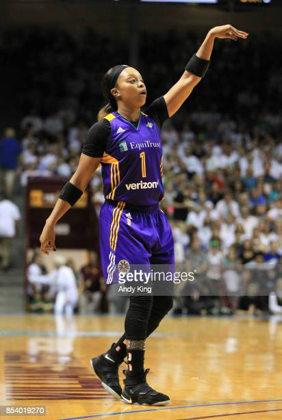 Odyssey Sims of the Los Angeles Sparks follows through against the Minnesota Lynx during the second quarter of Game One of the WNBA finals at...