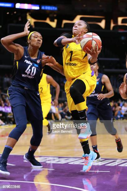 Odyssey Sims of the Los Angeles Sparks handles the ball against Kayla Alexander of the Indiana Fever during a WNBA basketball game at Staples Center...