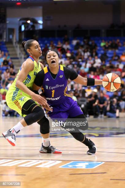 Odyssey Sims of the Los Angeles Sparks handles the ball against Skylar DigginsSmith of the Dallas Wings during a WNBA game on August 6 2017 at...