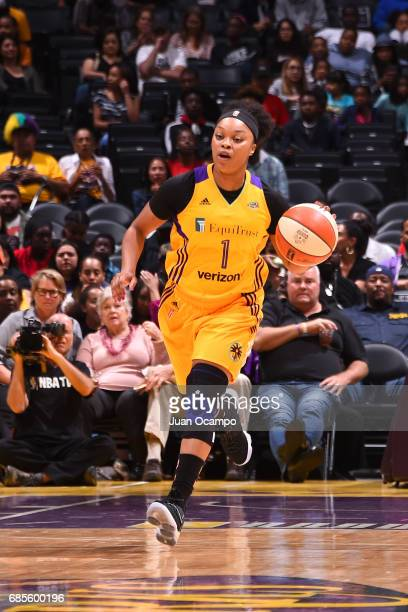 Odyssey Sims of the Los Angeles Sparks handles the ball against the Washington Mystics on May 19 2017 at STAPLES Center in Los Angeles California...