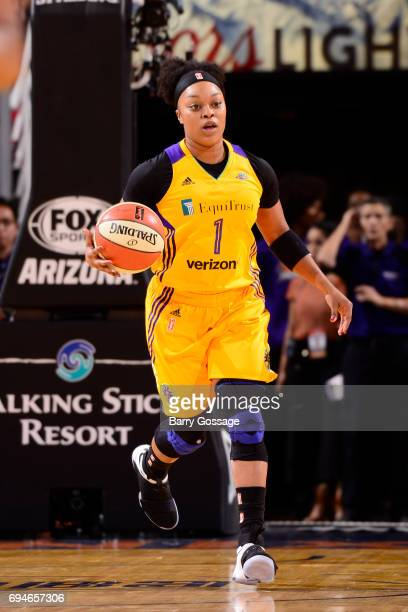 Odyssey Sims of the Los Angeles Sparks handles the ball against the Phoenix Mercury on June 10 2017 at Talking Stick Resort Arena in Phoenix Arizona...