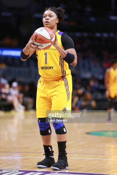 Odyssey Sims of the Los Angeles Sparks handles the ball against the Dallas Wings during a WNBA basketball game at Staples Center on June 13 2017 in...