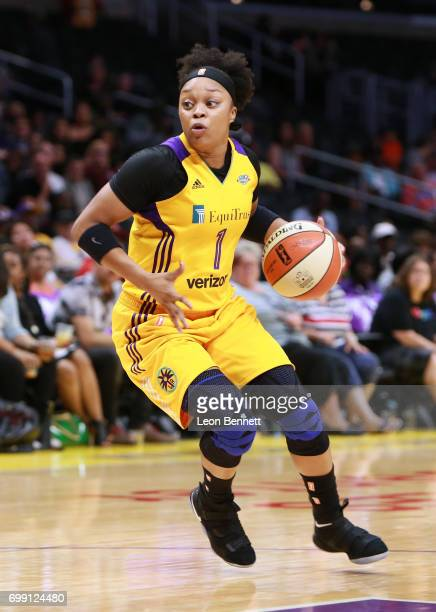 Odyssey Sims of the Los Angeles Sparks handles the ball against the San Antonio Stars during a WNBA basketball game at Staples Center on June 15 2017...