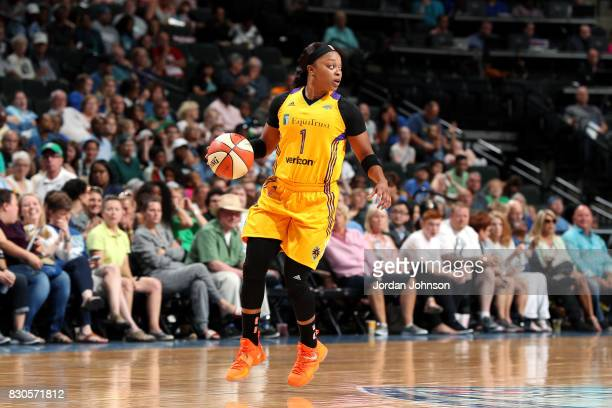 Odyssey Sims of the Los Angeles Sparks handles the ball during the game against the Minnesota Lynx during a WNBA game on August 11 2017 at Xcel...