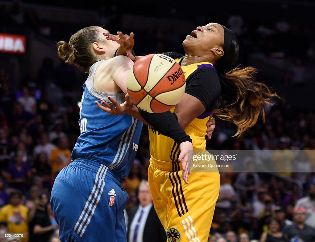 Odyssey Sims #1 of the Los Angeles Sparks is fouled by guard Lindsay Whalen #13 of the Minnesota Lynx as she goes for a layup during first quarter of Game Four of WNBA Finals at Staples Center October 1, 2017, in Los Angeles, California.