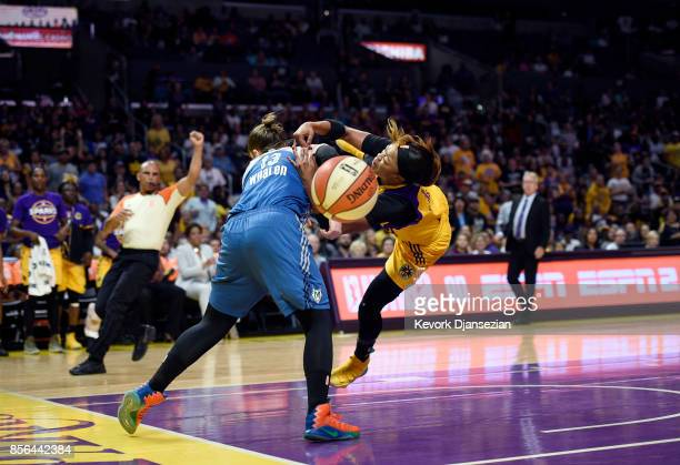 Odyssey Sims of the Los Angeles Sparks is fouled by guard Lindsay Whalen of the Minnesota Lynx as she goes for a layup during first quarter of Game...