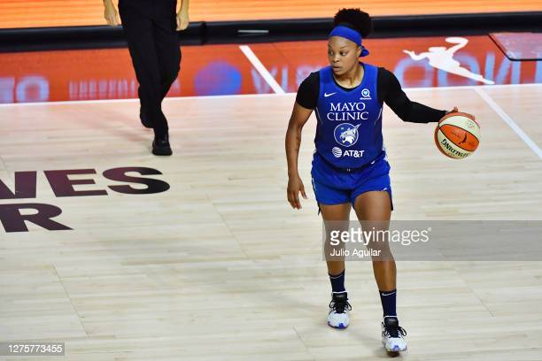 Odyssey Sims of the Minnesota Lynx dribbles during the second half against the Seattle Storm in Game One of their Third Round playoff at Feld...