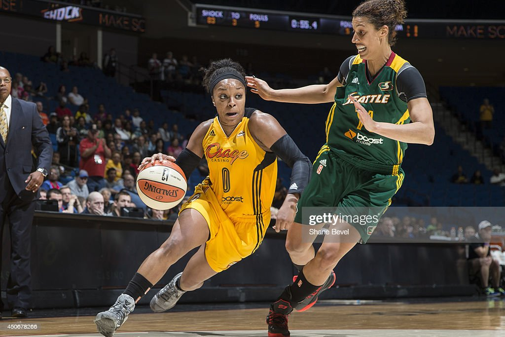 Odyssey Sims #0 of the Tulsa Shock drives against Nicole Powell #24 of the Seattle Storm during the WNBA game on June 15, 2014 at the BOK Center in Tulsa, Oklahoma.