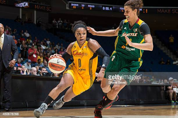 Odyssey Sims of the Tulsa Shock drives against Nicole Powell of the Seattle Storm during the WNBA game on June 15 2014 at the BOK Center in Tulsa...
