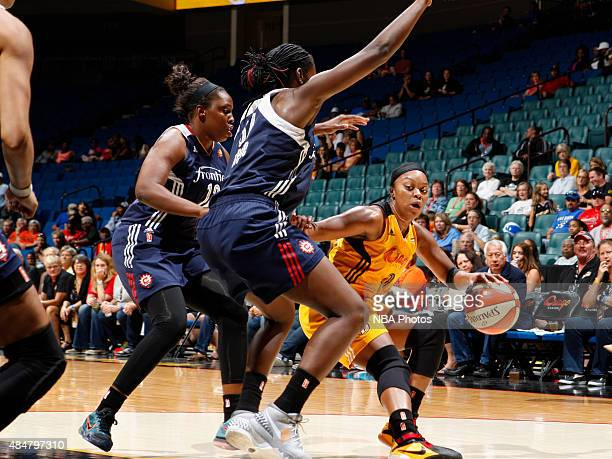 Odyssey Sims of the Tulsa Shock handles the ball against the Connecticut Sun on August 21 2015 at the BOK Center in Tulsa Oklahoma NOTE TO USER User...