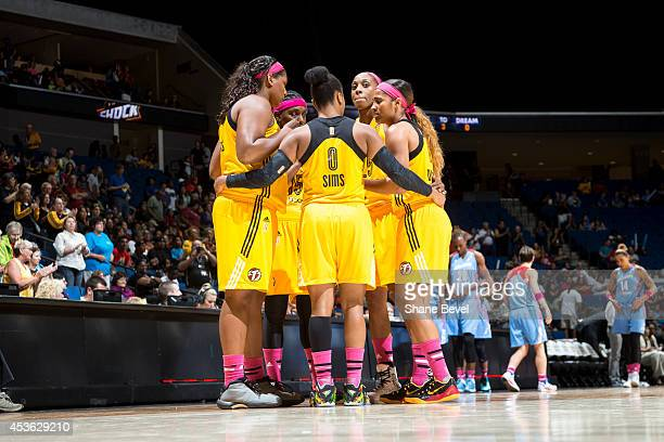 Odyssey Sims of the Tulsa Shock huddles with teammates against the Atlanta Dream during the WNBA game on July 29 2014 at the BOK Center in Tulsa...