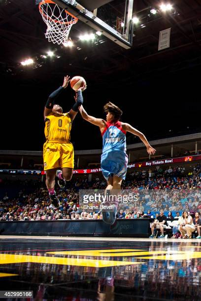 Odyssey Sims of the Tulsa Shock shoots against Shoni Schimmel of the Atlanta Dream during the WNBA game on July 31 2014 at the BOK Center in Tulsa...