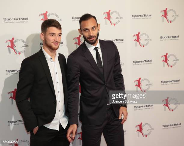 Oemer Toprak and Salih Oezcan pose at the 10th anniversary celebration of the Sports Total Agency on November 5 2017 in Cologne Germany