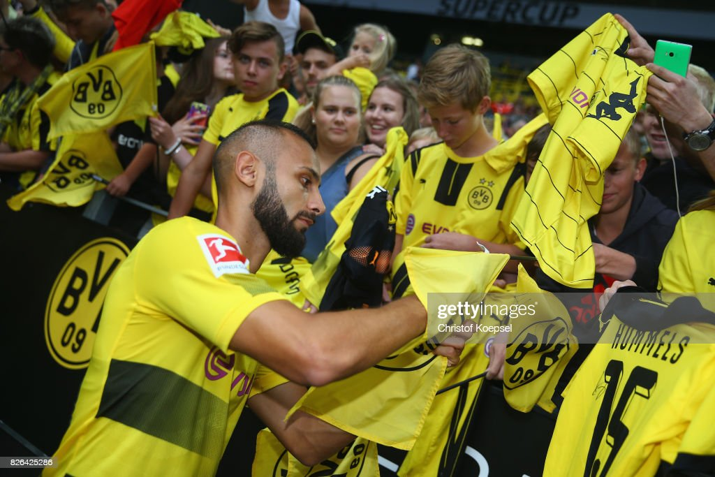 Oemer Toprak gives autographs during the Borussia Dortmund Season Opening 2017/18 at Signal Iduna Park on August 4, 2017 in Dortmund, Germany.