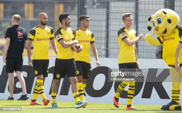 Oemer Toprak Nur Sahin Achraf Hakimi Marco Reus and mascot Emma of Borussia Dortmund are seen during the team presentation at Training Ground Brackel...