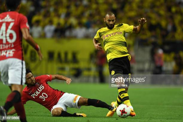 Oemer Toprak of Burussia Dortmund and Shinzo Koroki of Urawa Red Diamonds compete for the ball during the preseason friendly match between Urawa Red...