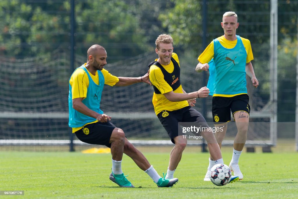 Oemer Toprak of Dortmund and Andre Schuerrle of Dortmund battle for the ball during a training session at BVB training center on July 12, 2018 in Dortmund, Germany.
