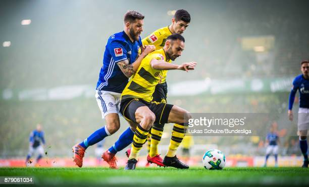 Oemer Toprak of Dortmund and Christian Pulisic attack Guido Burgstaller of Schalke during the Bundesliga match between Borussia Dortmund and FC...