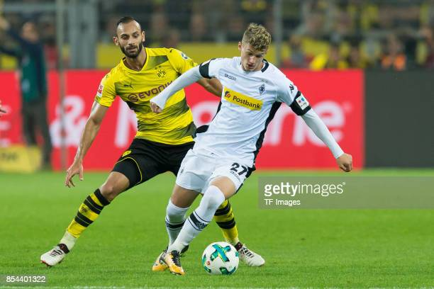 Oemer Toprak of Dortmund and Mickael Cuisance of Moenchengladbach battle for the ball during the Bundesliga match between Borussia Dortmund and...