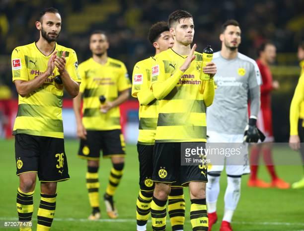 Oemer Toprak of Dortmund Jadon Sancho of Dortmund Julian Weigl of Dortmund and Roman Büerki looks dejected after the German Bundesliga match between...