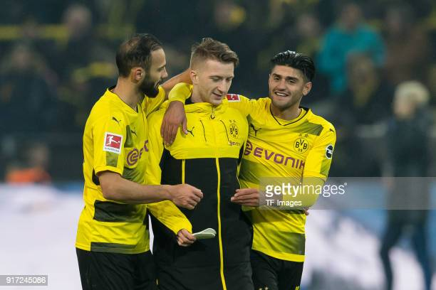 Oemer Toprak of Dortmund Marco Reus of Dortmund and Mahmound Dahoud of Dortmund celebrates after winning the Bundesliga match between Borussia...