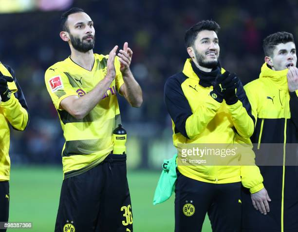 Oemer Toprak of Dortmund Nuri Sahin of Dortmund and Christian Pulisic of Dortmund celebrate after winning the Bundesliga match between Borussia...