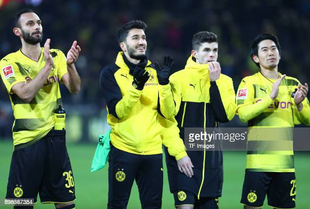 Oemer Toprak of Dortmund Nuri Sahin of Dortmund Christian Pulisic of Dortmund and Shinji Kagawa of Dortmund celebrate after winning the Bundesliga...