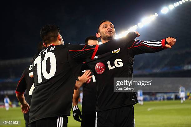 Oemer Toprak of Leverkusen celebrates his team's first goal with team mate Emre Can during the UEFA Champions League Group A match between Real...