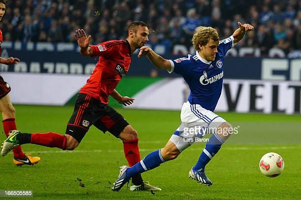 Oemer Toprak of Leverkusen challenges Teemu Pukki of Schalke in the penalty box during the Bundesliga match between FC Schalke 04 and Bayer 04...