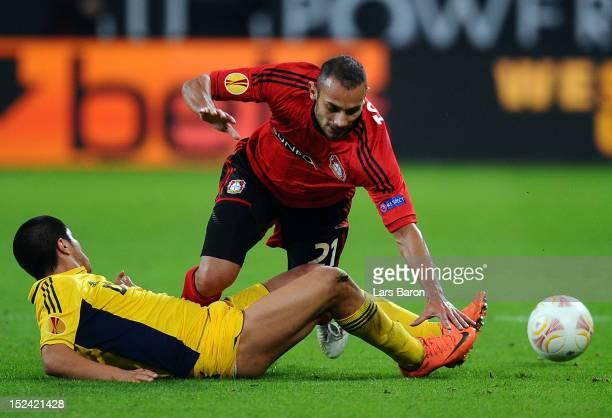 Oemer Toprak of Leverkusen is challenged by Jonathan Cristaldo of Kharkiv during the UEFA Europa League group K match between Bayer Leverkusen and FC...