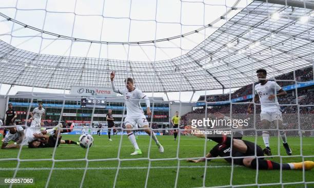 Oemer Toprak of Leverkusen saves the ball on the goalline during the Bundesliga match between Bayer 04 Leverkusen and Bayern Muenchen at BayArena on...