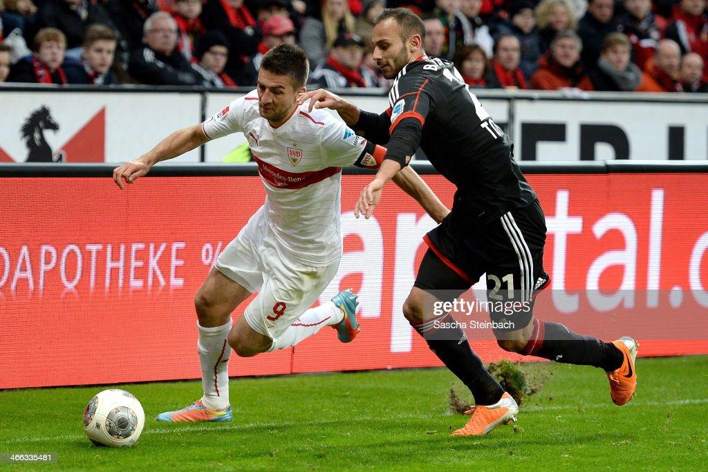 Oemer Toprak (R) of Leverkusen vies with Vedad Ibisevic (L) of Stuttgart during the Bundesliga match between Bayer Leverkusen and VfB Stuttgart at BayArena on February 1, 2014 in Leverkusen, Germany.