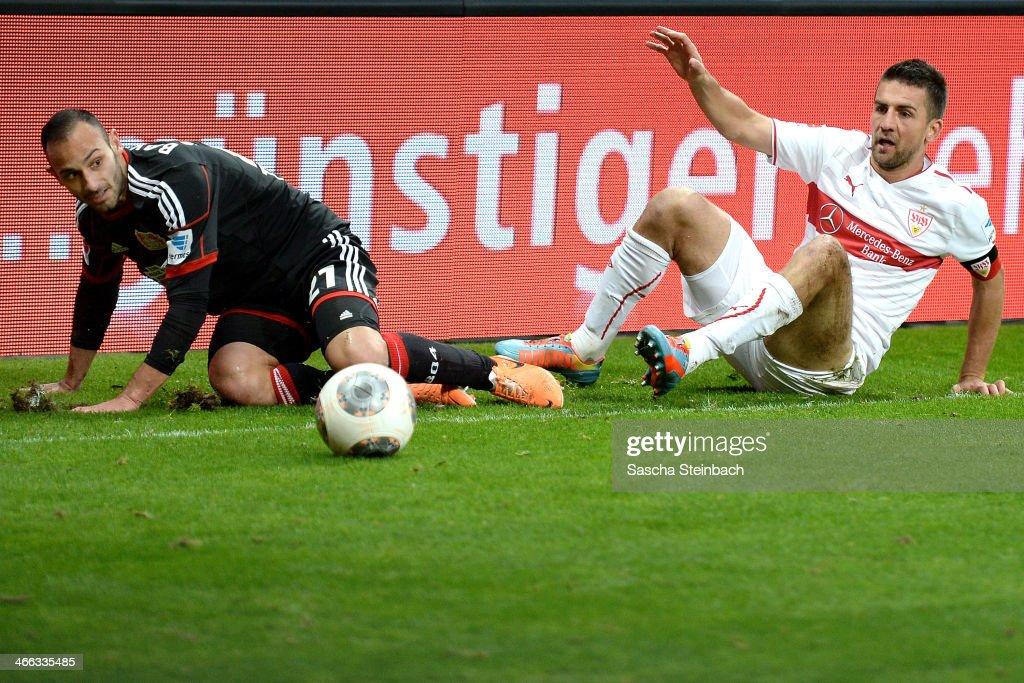 Oemer Toprak (L) of Leverkusen vies with Vedad Ibisevic (R) of Stuttgart during the Bundesliga match between Bayer Leverkusen and VfB Stuttgart at BayArena on February 1, 2014 in Leverkusen, Germany.