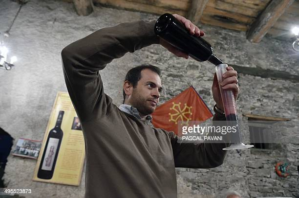 Oenologist Matthieu Dubernet tastes a blend of grapes from the DomusMaximus Chateau Massamier La Mignarde wineyard in the cellar of the domain in...
