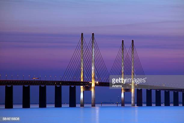 Oeresund / Ì÷resund Bridge, double-track railway and dual carriageway bridge-tunnel between Denmark and Sweden at sunset, Scandinavia.