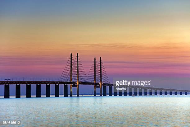 oeresund / Ì÷resund Bridge doubletrack railway and dual carriageway bridgetunnel between Denmark and Sweden at sunset Scandinavia
