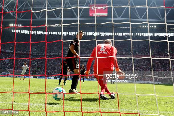 Oerjan Nyland of Ingolstadt and Tobias Schroeck of Ingolstadt get the first goal by Rouwen Hennings of Duesseldorf during the Second Bundesliga match...