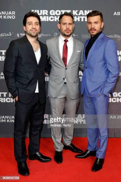 Oezgur Yildirim Moritz Bleibtreu and Edin Hasanovic attend the 'Nur Gott kann mich richten' premiere at CineStar Metropolis on January 22 2018 in...