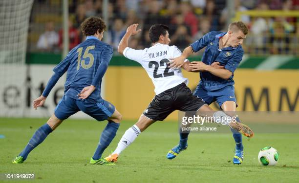 Oezkan Yildrim of Germany and Adrien Rabiot and Lucas Digne of France vies for the ball during the Under21 international friendly soccer match...