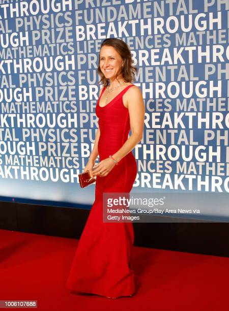 CEO of 23andMe Anne Wojcicki poses for the cameras at the 2016 Breakthrough Prize awards ceremony red carpet event at NASA Ames Research Center in...