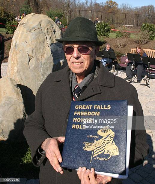 Of 6 fx/memorial, 11/13/04,Larry Morris TWP, #161822 : The man behind the project Pete Hilgartner with the book about those who are honored by the...