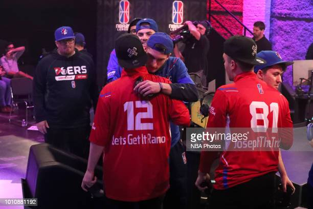 T of 76ers Gaming Club hugs Lets Get It Ramo of Pistons Gaming Team after the game between the two teams on August 4 2018 at the NBA 2K Studio in...